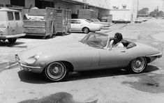 Dean Martin is stylin' as he drives up to NBC Studios in Burbank, CA, in his Jaguar XKE convertible in 1968.
