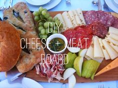 Cheese + Meat board. Cheeses: emmental, swiss, brie, stilton, Wensleydale, cheddar. Meats: german salami, chorizo. Fruits: grapes, clementines.