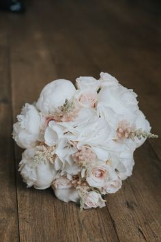Blush coloured bridal bouquet, including sweet avalanche roses, bombastic spray roses, white peonies, pale pink astilbe and white hydrangea.
