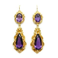 Mid-Victorian amethyst and gold pendant earrings, English c.1840, with pear shaped amethyst drops below oval cut tops, both claw set to gold scrollwork frames of bold openwork design. Length 9cm Weight: 29g