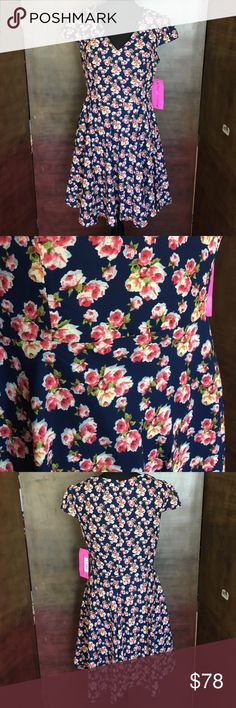 NWT Betsey Johnson Navy Floral Dress NWT Betsey Johnson Navy Floral Dress. The flowers are white and pink and orange yellow and white, with green leaves. Neck is a V. Inside is a Navy blue attached lining. 100% polyester. Measures approx 35 inches long. Betsey Johnson Dresses Asymmetrical