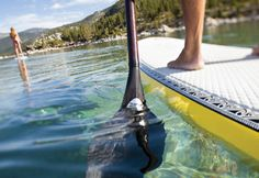 stand up paddleboarding - North Lake Tahoe.  Crystal clear but a little chilly.