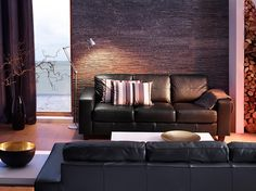 DARK living room  SKOGABY three-seat sofa with Robust black leather and LACK white coffee table