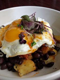 The Alvarado Bowl is slow cooked carne adovada, home fries, New Mexico red or green chile, white cheddar, black beans, topped with two eggs your way. Served until 3pm everyday only at Standard Diner in Albuquerque, NM!