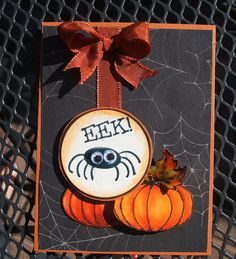 Halloween card...sophisticated design in black with Fall colors in pumpkins, leaves and ribbon...