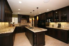 Kitchen : Stylish Dark Kitchen Design Ideas For Your Home Kitchen Black Kitchen Cabinets Wood Floors' Small Kitchen Design' Kitchens With Dark Cabinets also Kitchens Pvc Kitchen Cabinets, Dark Brown Kitchen Cabinets, Backsplash With Dark Cabinets, Brown Kitchens, Kitchen Cabinet Colors, Home Kitchens, Kitchen Backsplash, Backsplash Ideas, Granite Countertops