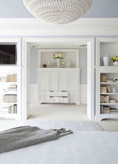 Love the use of white furniture!