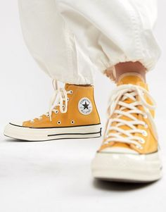 Browse online for the newest Converse chuck hi sunflower yellow sneakers styles. Shop easier with ASOS' multiple payments and return options (Ts&Cs apply). Yellow Converse, Converse Logo, Yellow Sneakers, Outfits With Converse, Converse Sneakers, Sneakers Fashion, Jean Outfits, Canvas Sneakers, Converse Haute