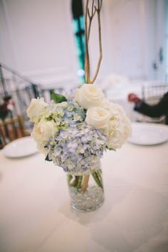 This table arrangement at Villa Serena consisted of blue hydrangea, white hydrangea, polo roses and gold twigs.