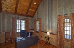 Poplar bark wainscoting and ghost wood walls in this unique, custom home office.This beautiful completely custom home is located on the Gorge side of 221S in Blowing Rock. Talk about fantastic, long range views and rustic mountain elegance! - VPC Builders