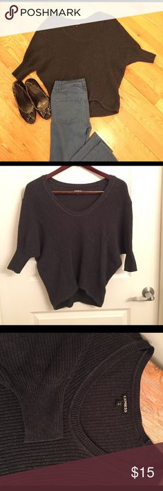 Express dolman sleeve sweater Charcoal gray, lovingly worn dolman sleeve sweater from express. Cut shorter. No signs of wear/tear. Size XS. Jeans & shoes shown are not included, but can be found in my closet 😄 Express Sweaters Crew & Scoop Necks