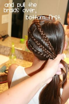 Three braids puled into a ponytail great for sports :)