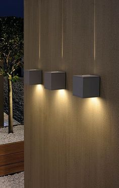 Ultimate guide to landscape and backyard lighting ideas for We explain every type with photos and then have amazing photo gallery of the best landscape lights. Find and save ideas about Backyard lighting in this article. See more ideas about Diy bac Backyard Lighting, Outdoor Wall Lighting, Outdoor Walls, Home Lighting, Modern Lighting, Lighting Ideas, Modern Lamps, Rooftop Lighting, Fence Lighting