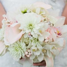 Bouquet with bling, calla lilies, dahlias, roses, and orchids. @Logan Wilson@Brooke Merriman-Scoggins
