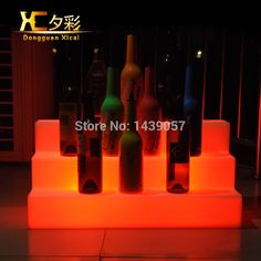 Cheap bar display shelves, Buy Quality platform Directly from China Suppliers:Plastic LED Wine Holder Luminous Display Shelf Color Changing Platform For Bar Home Wedding Ceremony Party Home Wedding, Wedding Ceremony, Bar Furniture, Display Shelves, Bars For Home, Lava Lamp, Shelf, Platform, Plastic