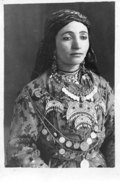 Kurdish Woman in her traditional Dress and the typical Handmade Jewelry. Date unknown.