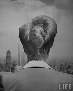 A woman showing her fashionable upsweeping hairstyle. Location: US Date taken: 1943 Photographer: Nina Leen