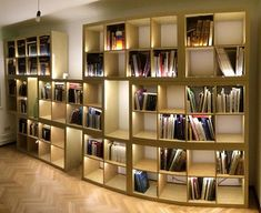 Custom curved buit-in shelves with accent lighting - beautiful! Now you just need some records to fill them...