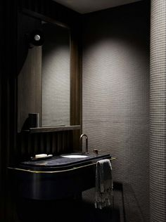 Lynch articulated an adjacent bathroom as a luxury cave, scaling black in tint and texture from cold Nero Marquina stone to earthy ebony to the warm matte of Boffi's 'Morocco' mosaics. Brown Bathroom, Gold Bathroom, Bathroom Sets, Bathroom Interior, Modern Bathroom, Mosaic Bathroom, Bathroom Bin, Bathroom Small, Basement Bathroom