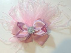 Pink Satin Iridescent Pink Feather Hair Bow.  Handmade  by FancyGirlBoutiqueNYC  Buy it on Esty.