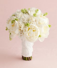 Bouquet of white peonies, white lilac buds, double lisianthus, and white nerine