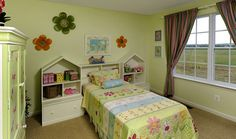 This large secondary bedroom makes the perfect child's room. Notice the large window to bring in the sunlight. Child's Room, Home Photo, Large Windows, Sunlight, Kids Room, Toddler Bed, Photo Galleries, Bedrooms, New Homes