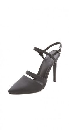 ESTHER SLINGBACK PUMPS $81.93 Matte leather looks modern and elegant on these pointed-toe Tibi pumps, styled with slim straps. Buckled ankle closure. Stacked heel and leather sole.