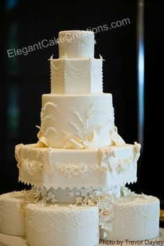 Roses and Lilies Wedding Cake by Elegant Cake Creations AZ, via Flickr