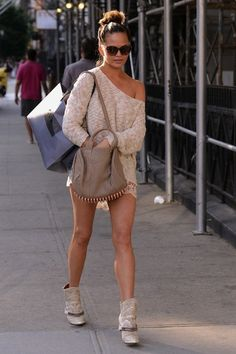 The nude and taupe look so good against her tan. Everyone likes a off the shoulder lace dress to show off your legs