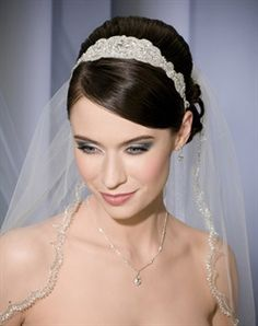 Beaded organza headband with ties in back. Shown with 1 layer fingertip length veil with scallop & beaded embroidery along edge (V7097).