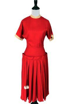 Dressing Vintage - Vintage Christmas red wool 1950s dress with pom poms, $295.00 (http://dressingvintage.com/vintage-christmas-red-wool-1950s-dress-with-pom-poms/)
