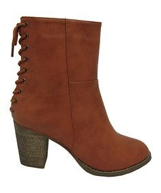 Brown Corset Alpha Ankle Boot by Yoki   A corset back secures the smooth, Victorian-inspired silhouette of these ankle-hugging boots, while a stout stacked heel ensures a reliable stride.   3'' heel 6'' shaft 10'' circumference Lace-up / inside zipper closure Man-made vegan and cruelty free leather look without the cruelty!  Cute boots heels