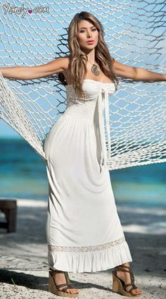 White Summer Maxi Dress - This long white, summer maxi dress features a strapless silhouette, long front tie and elastic bodice and ruffled hem.