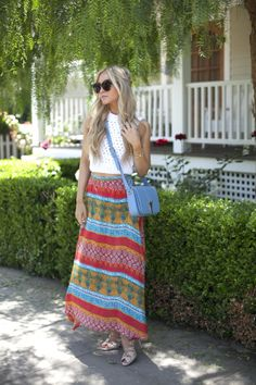 A crochet top and flowy printed skirt creates a comfortable bohemian vibe – perfect for an afternoon stroll in Venice Beach. Maxi Outfits, Crop Top Outfits, Casual Outfits, Street Snap Fashion, Cozy Winter Outfits, Dress Attire, Printed Maxi Skirts, Midi Skirts, Types Of Fashion Styles