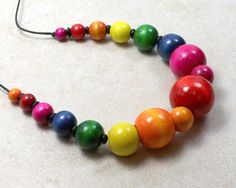 Awesome Etsy listing at http://www.etsy.com/listing/98652749/nursing-necklace-with-rainbow-wooden
