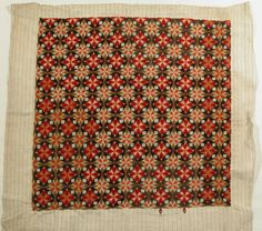1700 - 1720, Cushion cover - German canvas (jute). Square of embroidery from a cushion cover. Worked in Berlin wool in Florentine stitch in very geometrical pattern based on octagon and squares. Colours - reds, yellow-greens, black and pale blue. 20 inches (508mm) square. Label 'Belonged to Mrs Wade at Yoxford', Snowshill Wade Costume Collection, Gloucestershire,   National Trust Inventory Number 1348941
