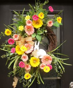 Gerber Daisy Wreath, Bunny Wreath, Spring Wreaths, Easter Wreath, Spring Door Wreath Pretty Gerber daisies are in bloom in this cheerful Easter wreath. This door wreath will make your home smile.  35 tall X 28 wide (including grassy stems) Bulk width is about 21-22 X 7-8 Deep Measurements are tip to tip (includes trailing greenery & grasses). Designed on a grapevine wreath base.  All materials used are a beautiful quality for lasting enjoyment & realistic impressions.  You may use out...