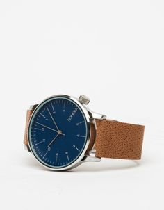 Winston watch from KOMONO, features a stainless steel case, Japanese quartz movement, and a deep navy face with a genuine leather, cognac tanned strap.   •Stainless steel wristwatch  •Stainless steel case •Navy blue face •Japanese quartz move