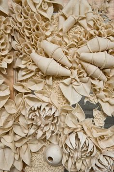 Miko : This is a 3D Textiles piece, an organic textile creation; decorative three-dimensional florals and textures inspired by nature; fabric manipulation.
