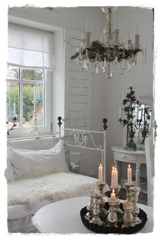 white iron daybed and pretty chandelier.