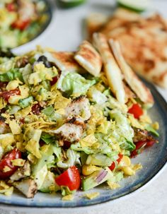 135 different recipes for superbowl eats, including this chicken taco salad with cheese quesadilla strips!  | howsweeteats.com