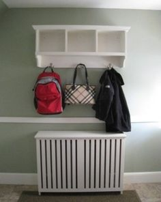 Custom, solid wood radiator cover/enclosure with a perfectly sized coat and cubby shelf above it.
