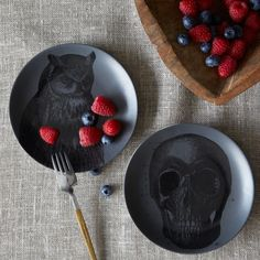 Elegant Decor detailed drawings on rich gray porcelain, the West Elm Spooky Canape Plates ($5-$6)