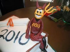 This was a cake I made from my niece for her graduating from ASU :)  Iade Sparky out of fondant :)