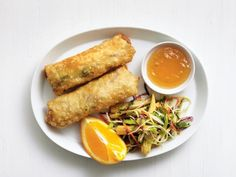 Get Chicken Egg Rolls with Broccoli Slaw Recipe from Food Network