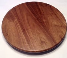 This here is a Black Walnut lazy susan. Wood comes from a nearby sawmill. The one in the picture was 16 inches across and sits 1.75 inches above your countertop or table surface.     Features a quality USA made bearing set. Wood is sanded to 320 grit, then three coats of semi gloss finish is applied.     Start a conversation if you would like a custom size or different type of wood.    BUILD TIME IS ONE WEEK    Thank you for looking