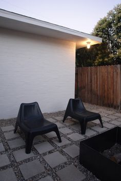The Brick House - concrete paver patio, IKEA chairs, DIY welded fire box.