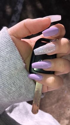 There are three kinds of fake nails which all come from the family of plastics. Acrylic nails are a liquid and powder mix. They are mixed in front of you and then they are brushed onto your nails and shaped. These nails are air dried. Purple Acrylic Nails, Best Acrylic Nails, Light Purple Nails, Acrylic Summer Nails Coffin, Violet Nails, Coffin Nails Long, Acrylic Nail Designs Coffin, Purple Nails With Glitter, Acrylic Nails With Design