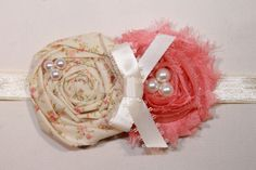 Rose Coral and Ivory Rosette Baby Flower Headband, Newborn Headband, Baby Girl Flower Headband, Photography Prop. $11.95, via Etsy.