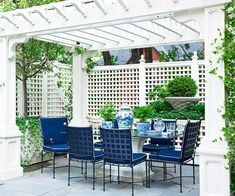 lattice fence, pergola, & table form outdoor room - 10 Ways to Create a Backyard Getaway Outdoor Rooms, Outdoor Dining, Outdoor Gardens, Outdoor Furniture Sets, Outdoor Decor, Party Outdoor, Dining Area, Outdoor Seating, Store Pergola